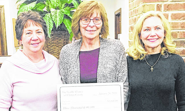 Cindy Petrich (left) and Kathy Havey (right), representatives from the Health Alliance Clinton County, presented Patti Settlemyre (center), retired executive director and founder of Community Care Hospice, with a $3,000 donation for patient care.