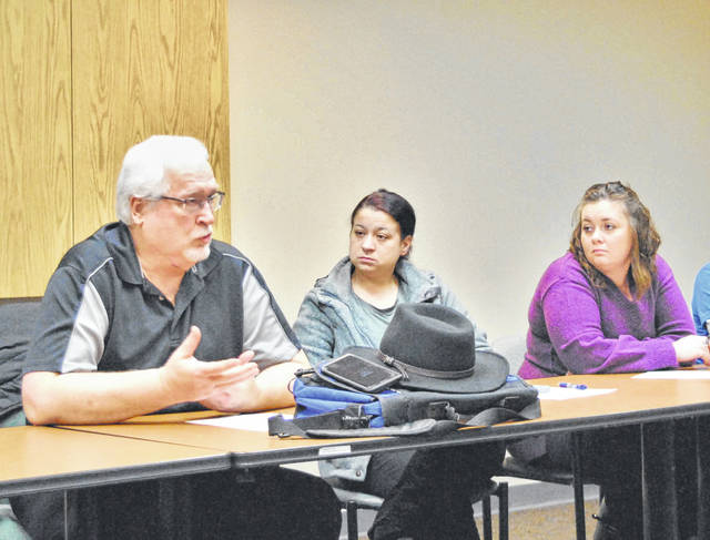Jack Stem, left, a former nurse anesthetist, shares his struggle with addiction at Thursday's Highland County Drug Coalition meeting. Also pictured: Adams and Brown Ohio Means Jobs representatives Callie Post, middle, and Mariah Powell, right.