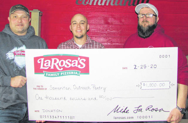 Samaritan Outreach Services in Hillsboro was presented with a check for $1,000 from LaRosa's on Tuesday. Samaritan Outreach Director Wade Hamilton said that the donation would go a long way to helping the local non-profit continue its mission of operating a full-choice food pantry for the area's needy. Shown, from left, are Hillsboro/Mt. Orab LaRosa's Owner Tim O' Hara, Hillsboro/Mt. Orab District Operations Manager Shawn Shelton and Wade Hamilton with Samaritan Outreach.