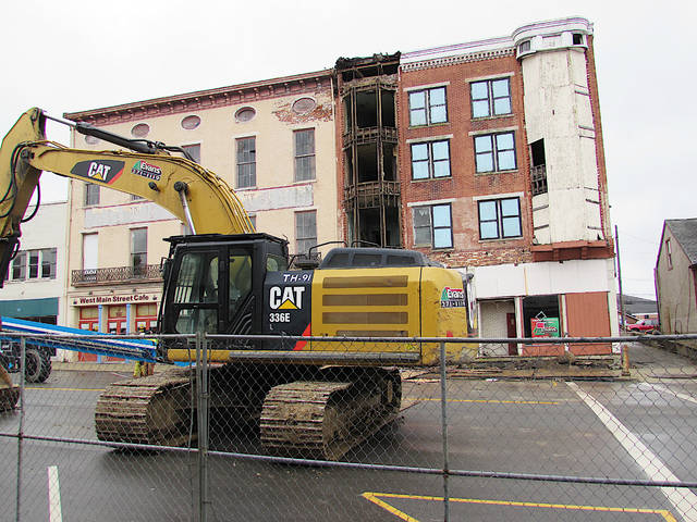 Part of the facade of the Parker Hotel (the right portion of the building in this photo) started coming down Monday. City of Hillsboro officials expect the structure to be gone by the end of the week.