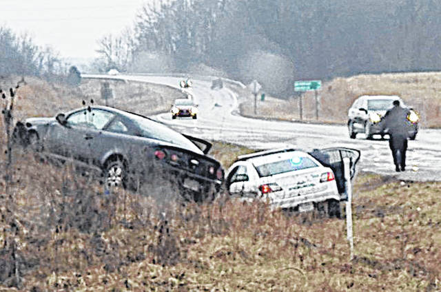 An allegedly stolen vehicle and a Greenfield Police Department cruiser are pictured where the driver of a fleeing car crashed Wednesday at the intersection of SR 28 and SR 41.