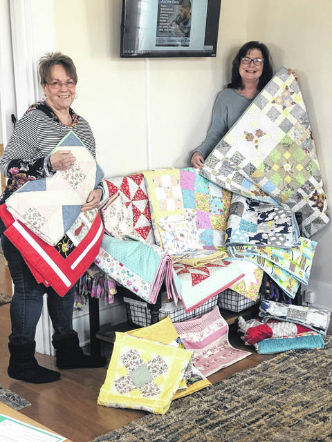 The Highland County Country Quilters recently made an annual donation to the Southern Ohio Pregnancy Center, according to club spokesperson Nancy Sonner. Accepting the quilt donations were SOPC Director Deanna Smaltz, left, and director of client services Sheri Kuha.