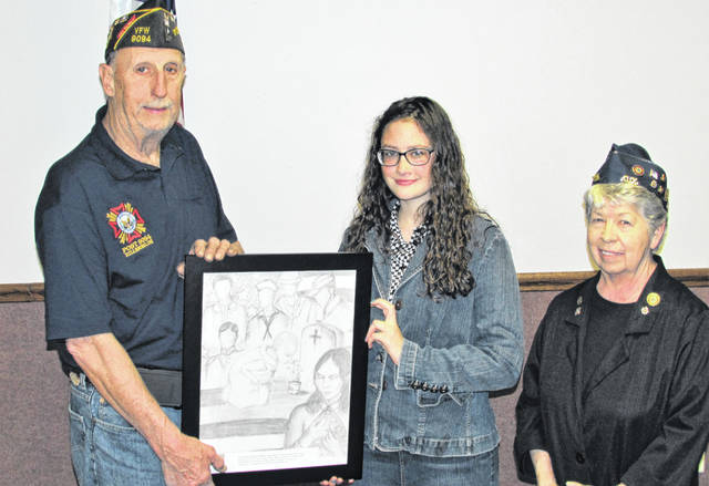 Last fall, Isabella O' Madden entered her original artwork in the VFW's Young American Creative Patriotic Art contest and won first place in the local competition. She later was the first place winner of the District 4 Auxiliary of Ohio competition, besting artistic creations in the district's 12 counties. O' Madden presented her artwork to VFW Post 9094 Friday evening to be placed alonside the other patriotic creations that hang in the VFW's dining hall. Shown, from left, are VFW Post Commander Rick Wilkin, Isabella O' Madden and Post Auxiliary Chair Shirley Wilkin.