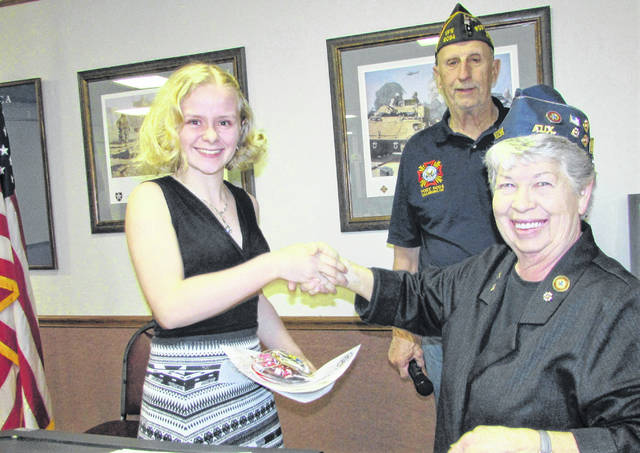 Hillsboro VFW Post 9094 held an awards ceremony for the winners of the Voice of Democracy and Patriot's Pen essay contests Friday evening. Shown, from left, are Anne Throckmorton, this year's first place winner in the the local Voice of Democracy competition, along with Post Commander Rick Wilkin and VFW Auxiliary Chair Shirley Wilkin.