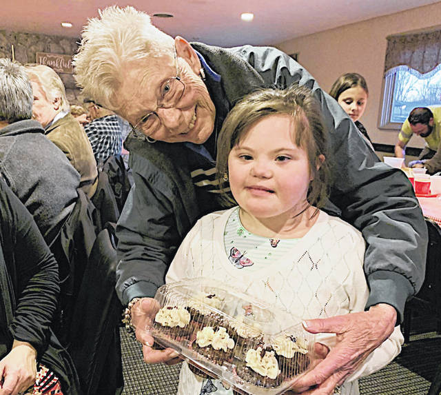Highland County Society for Children and Adults Executive Secretary Gayle Coss is pictured with 2020 Poster Child Elisha Duncan last week at the 16th annual Chili Supper and Dessert Auction.