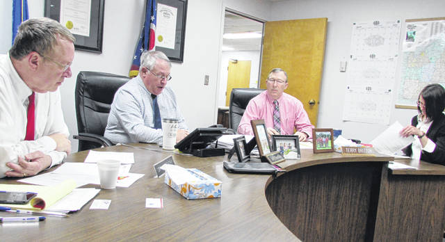 Shown from left, are commissioners Gary Abernathy, Jeff Duncan and Terry Britton, and clerk Mary Remsing during Wednesday's meeting.