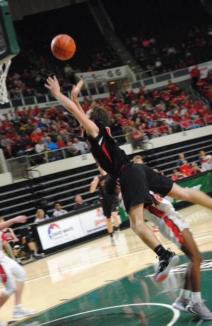 Fairfield Lions' senior Wyatt Willey going up for a layup attempt during District semifinals against Glenwood New Boston.