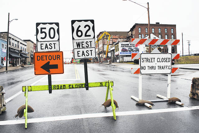 Barriers are shown Tuesday blocking traffic to the 100 block of West Main Street in Hillsboro. The Parker Hotel that is under demolition can be seen in the background on the right.