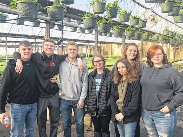Hillsboro FFA Advisors Mrs. McNeal recently took seven FFA members that are in her greenhouse class to Patchwork Gardens Greenhouse in Washington C.H. During the visit, Mrs. Wilt, the owner of Pathwork, showed the members around the garden center business and explained the process the plants go through during their time in the greenhouse. After the tour, the greenhouse class purchased several different plants to bring back to Hillsboro High School and grow in their greenhouse. Later on in the year, the Hillsboro FFA greenhouse class will be selling hanging pots, bedding plants, deck planters and more that include some of the plugs that were bought during their trip to Patchwork Gardens. Pictured, from left,are Garrett Fannin, Brock Haines, Alex Rensing, Kelcie Thornburgh, Gracie Isaacs, Haley Hughes and Neveah Colville.