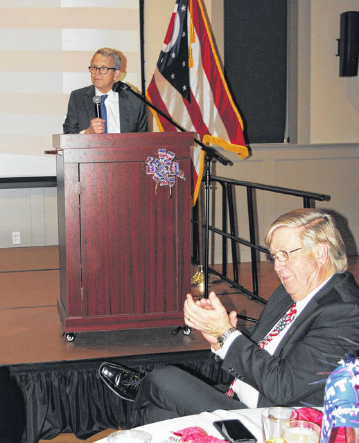 Ohio Governor Mike DeWine (at the podium) was at the Hillsboro Orpheum Friday evening as guest speaker at the annual Highland County GOP Lincoln Day Dinner. Pictured in the foreground is Orpheum owner Dale Martin. Highland County Republican Club Secretary/Treasurer Paulette Donley said about 230 people attended the event. The governor's wife, Fran DeWine, presented a program for the Ohio Governor's Imagination Library earlier in the day at the Hillsboro library.