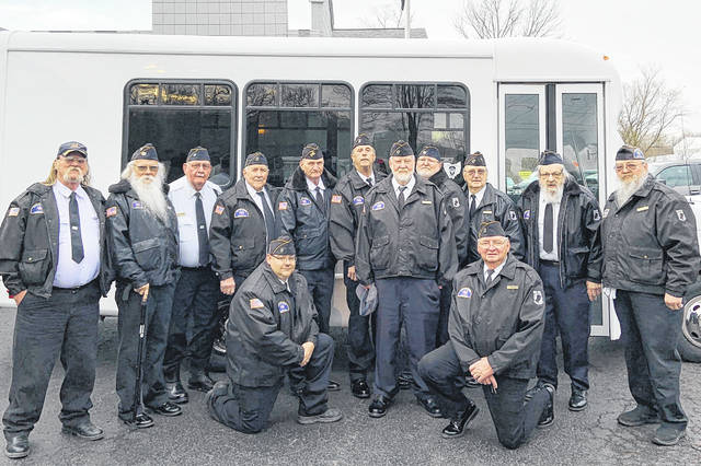 "Highland County Veterans Honor Guard members are pictured with a new van they were able to purchase recently thanks to donation to help them travel to veterans' funerals and other events. ""Thanks to everyone who donated funds for the new bus. We appreciated that very much,"" Honor Guard Commander John Walker said."