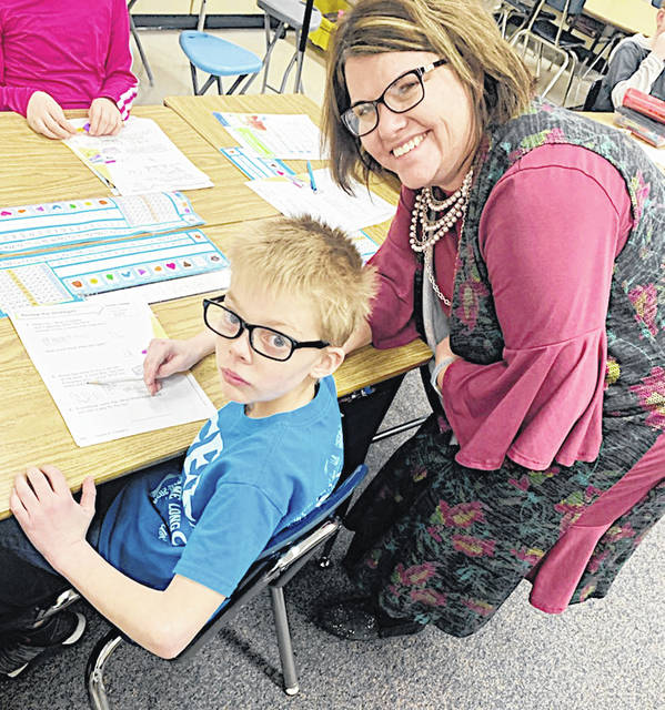 Amber Iseman works with one of her students at the Greenfield Elementary School.