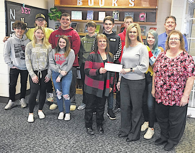 Merchants National Bank employees (right) are pictured making a $500 donation to the Hillsboro High School After Prom Party. Pictured accepting the check are After Prom Committee member Elaine Gilliland and Hillsboro High School students.
