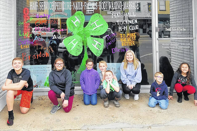 Members of the Marshall Stockmen 4-H Club decorated the window at Details Salon and Day Spa in honor of Highland County 4-H Week. Members pictured, from left, are Cameron Burkard, Hailey Cornett, Molly Vance, Braydon Burkard, Ashton Burkard, Lexi Denny, Travis Denny and Jayona Kibler.