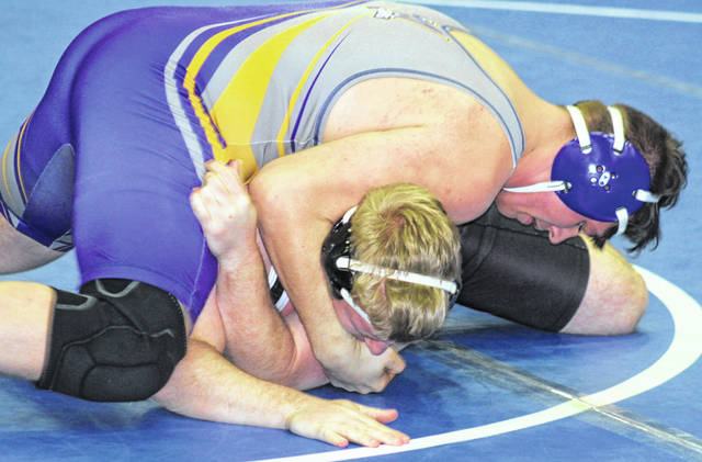 First placer finisher Kade Rawlins of McClain against Panthers' David Tyndell during the Sectional Tournament for Division II wrestling.