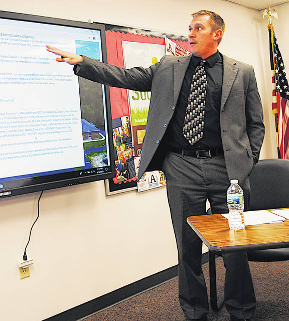 Superintendent Tim Davis points to the Hillsboro City Schools website during Monday's board of education meeting.