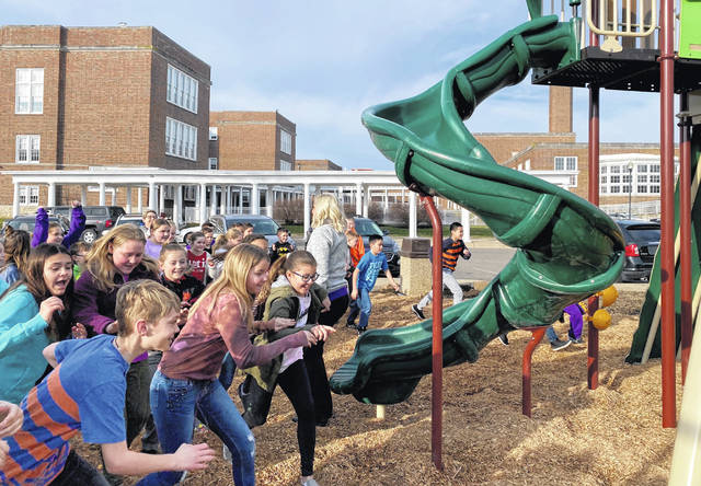 Greenfield Elementary fifth grade students run to explore the new Imagination Kingdom during the playground's official opening Thursday morning.