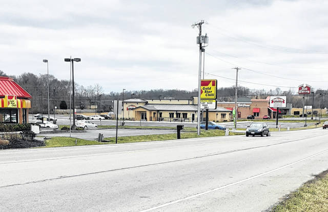 """""""Restaurant Row"""" on Harry Sauner Road in Hillsboro, usually busy with crowded parking lots, looked eerily deserted Monday in light of Gov. DeWines order that restaurants remain closed over fears of COVID-19 spread."""