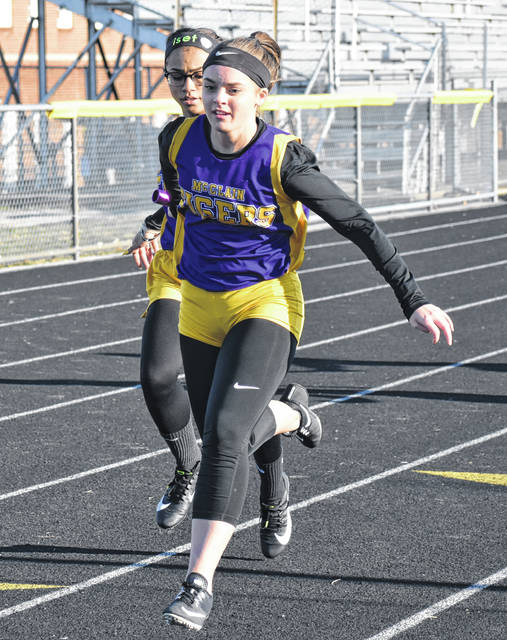 McClain Senior Ashley Hardesty receiving a handoff during the 4x100 relay during the 2019 track and field season.