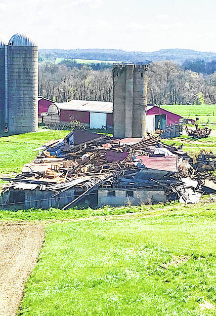 This multi-story, 1800s era barn on the east side of Hillsboro along SR 138 and owned by Adam Vance was completely flattened by Wednesday night's storms.