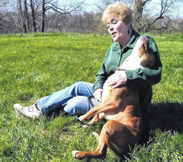 Friends of the Highland County Dog Pound member Pat Lawrence sits with Chevy, this week's Highland County Dog Pound Pet of the Week.