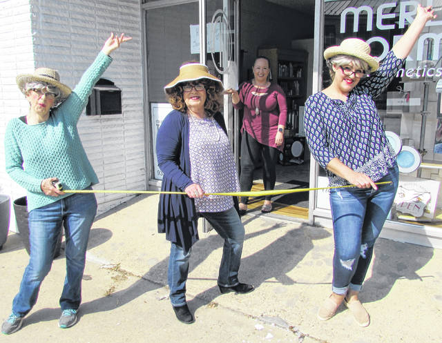 Direct from Maysville, Ky., the Covid Sisters have gone from Facebook to the streets of Hillsboro to promote local businesses in anticipation of reopening on Tuesday, May 12. One of the stops on their tour was the Merle Norman cosmetic studio in uptown Hillsboro as Idella, Corona and Covella checked up on owner/manager Rachelle Trefz. Shown from left are Idella (Jo McFarland of Main Street Apparel & Tux), Corona (Sharon Hughes of The Times-Gazette), Rachelle Trefz and Covella (Sarah Roe of The Mortgage Pro).