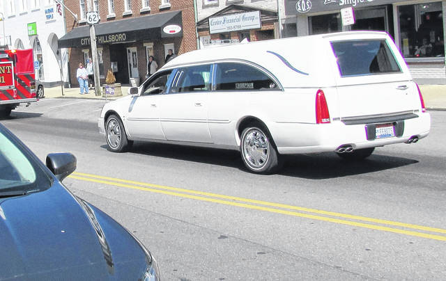 A hearse carrying the body of longtime Hillsboro public servant Joe Mahan was part of a line of vehicles that stretched nearly half a mile as the city of Hillsboro said good-bye Friday to the former two-time president of the Hillsboro Uptown Business Association. The funeral processional parade meandered through the city along a route that both saluted the local businesses he owned and those he vigorously promoted. Family, friends and colleagues lined the streets of the parade route. Nearly 50 vehicles driven by other business owners and the Eagle Riders motorcycle club from Hillsboro Eagles Aerie 1161 followed the hearse from the Thompson Funeral Home for the final trip up North High Street and burial in the Hillsboro Cemetery. Mahan, 50, passed away unexpectedly March 29.