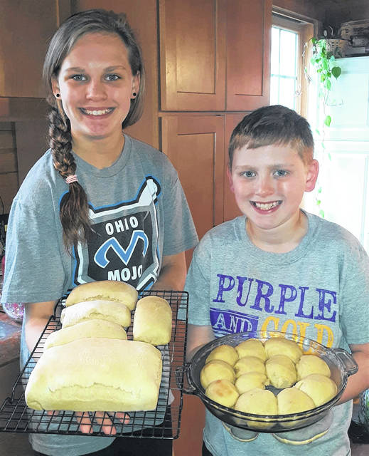 After giving some of their homemade bread to family members and the Greenfield Elementary principal, Jamie Peabody and children Hunter and Harley decided to make another batch using a recipe handwritten by the kids' late great-great-grandmother, Junie Skidmore. In this picture, Harley (left) and Hunter hold loaves and rolls from the second batch.