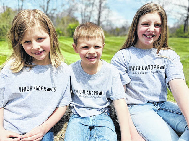 Highland County Chamber of Commerce Executive Director Destiny Bryson's children are pictured wearing new #HighlandProud T-shirts. From left, are Mallory, Bennett and Reece Bryson.