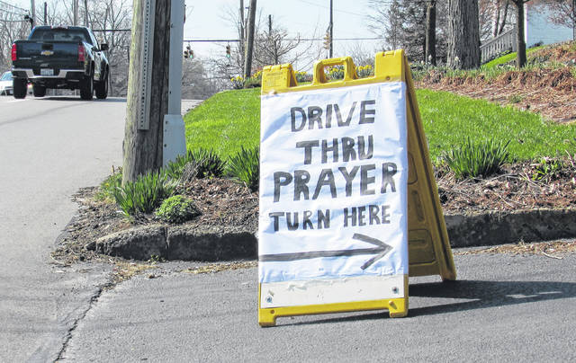 A sign Sid and Theresa Raisch put up at the entrance to their driveway on North High Street in Hillsboro to give hope in troubled times is pictured.