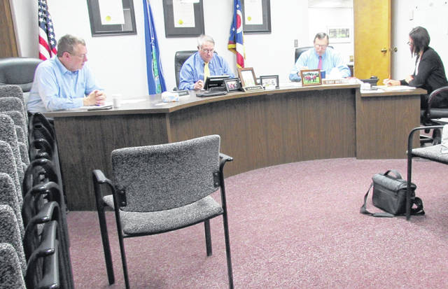 Shown, from left, are commissioners Gary Abernathy, Jeff Duncan and Terry Britton, and clerk Mary Remsing during Wednesdays regular meeting, held in the commissioners' chambers reflecting current social distancing recommendations.