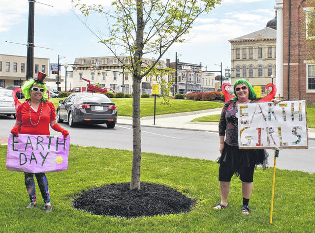 Hillsboro sisters Cindy and Nancy (last names withheld) told The Times-Gazette they've been dressing up in bright costumes and colorful wigs for the last month in an effort to make people smile. On Wednesday, the sisters celebrated the 50th Earth Day with green wigs, fairy wings and Earth Day signs while walkiing in the uptown Hillsboro area. They also plan to dress up and walk through uptown Hillsboro on Friday for Arbor Day and on May 4 for Star Wars Day.