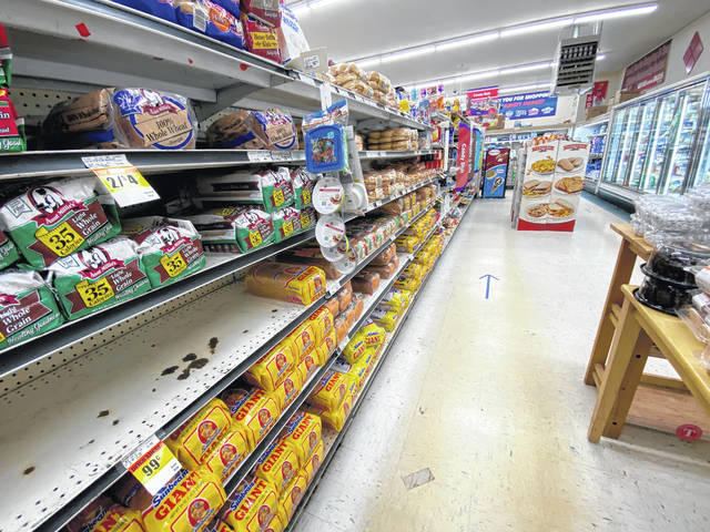 Though shelves aren't as bare as they were near the beginning of the COVID-19 outbreak, families are still struggling to afford and obtain the items they need. This picture taken Wednesday at Community Markets in Hillsboro.