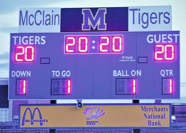McClain High School lights up the scoreboard with 20:20 on the clock.