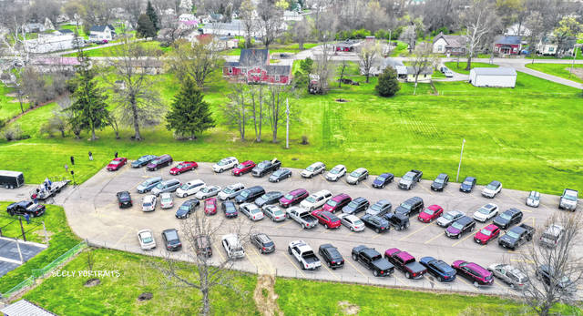 Around 70 vehicles pulled into Mitchell Park in Greenfield on Sunday evening for the Greenfield Area Ministerial Association's Palm Sunday drive-in church service.