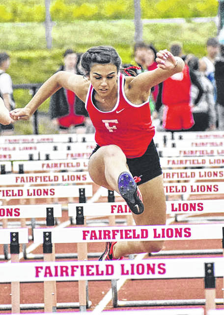 Fairfield senior Ailean Duffie running the 100 hurdles during the 2019 season