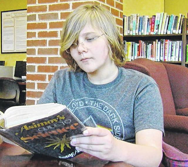Most 12-year-olds are finishing up projects for their sixth-grade classes, but Hillsboro 12-year-old Lucius Garrity has just earned an associate's degree.