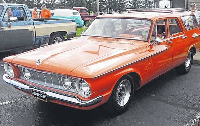 """Cars are lined up waiting to """"bop the circuit"""" Saturday evening in Greenfield."""
