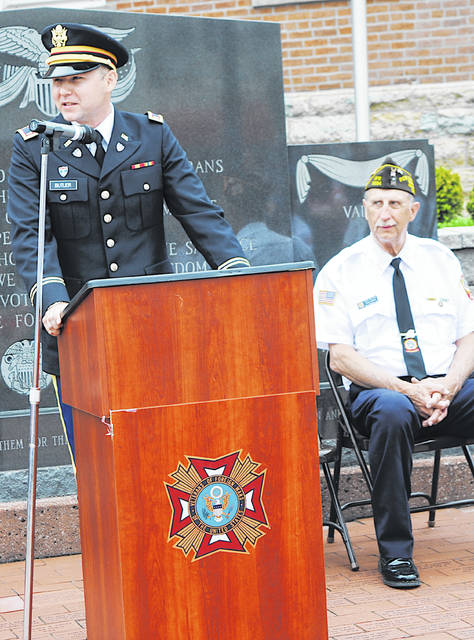 Alex Butler, pictured speaking at Memorial Day ceremonies last year in Hillsboro, will be the Memorial Day speaker this year in Pricetown. Seated is Hillsboro VFW Post 9094 Commander Rick Wilkin.