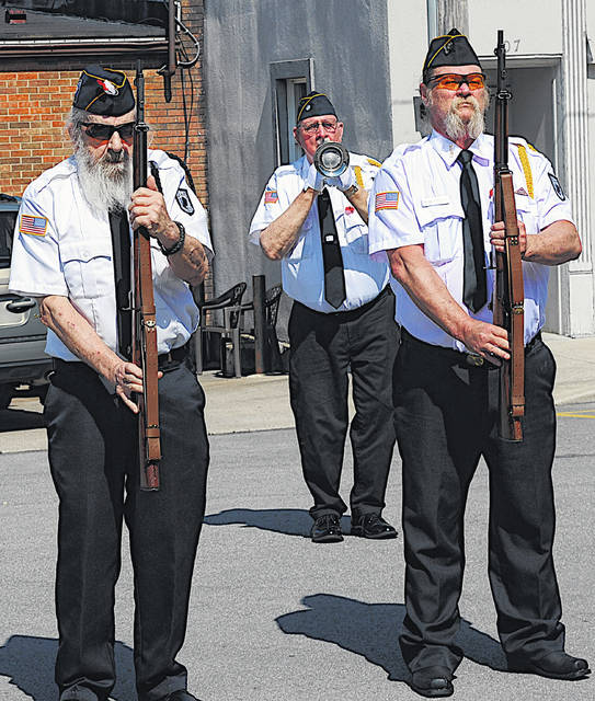 Taps is played prior to a rifle salute Monday during Memorial Day services in Hillsboro.