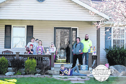 The Parker family poses for a family portrait as part of photographer Kensly Jett's Front Porch Project, which documents Greenfield families' lives during Ohio's stay-at-home order.