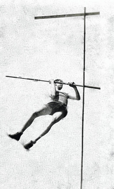 Ed Ayres shown pole vaulting during his years of high school track and field.