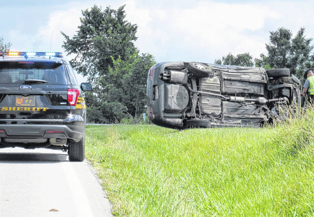 A Toyota Camry rests on its side following a two-vehicle rollover crash Monday afternoon on SR 136, approximately 1.5 miles south of the intersection with U.S. Routet 62.