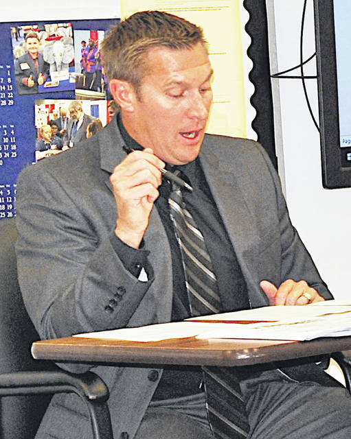 Hillsboro Superintendent Tim Davis gives his report during Monday's board of education meeting.