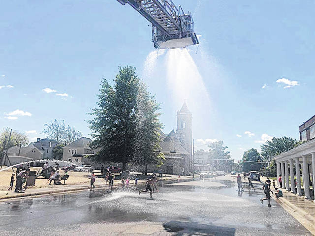 The Paint Creek Joint EMS/Fire District held the second of three Water Days on Friday in Greenfield. Kids are pictured playing in the sprays. The final Water day will be held from 11 a.m. to 1 p.m. Friday, July 10 at Paint Creek's Hillsboro station.
