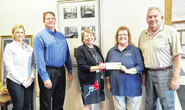 Merchants National Bank makes annual payment to the Highland District Hospital Foundation GreatER Care Campaign, completing its pledge declaration which spanned the last five years. This campaign which began in 2016 and is part of an effort to raise $1.5 million toward the renovation and expansion of the emergency department at the hospital. Because of donations, pledges and support like that from Merchants National Bank, the end of the campaign will close at the intended goal of $1.5 million. For more information on the GreatER Care Campaign, call Cathy Jones at 937-393-6360. Pictured, from left, are Denise Fauber, MNB vice president of business administration; Jeff Meyer, MNB branch manager; Cathy Jones, Highland District Hospital Foundation director; Bertha Hamilton, MNB chairman secretary and marketing director; and Paul Pence, CEO and chairman of the board for Merchants National Bank.