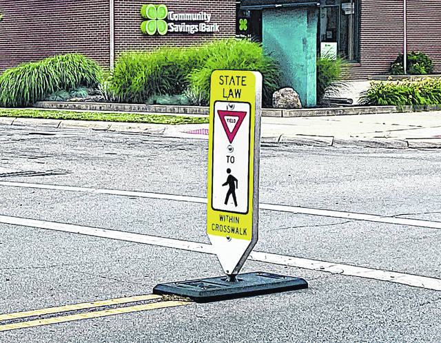 The village of Greenfield installed six signs in crosswalks like this one located at the intersection of Jefferson Street and Fourth Street.
