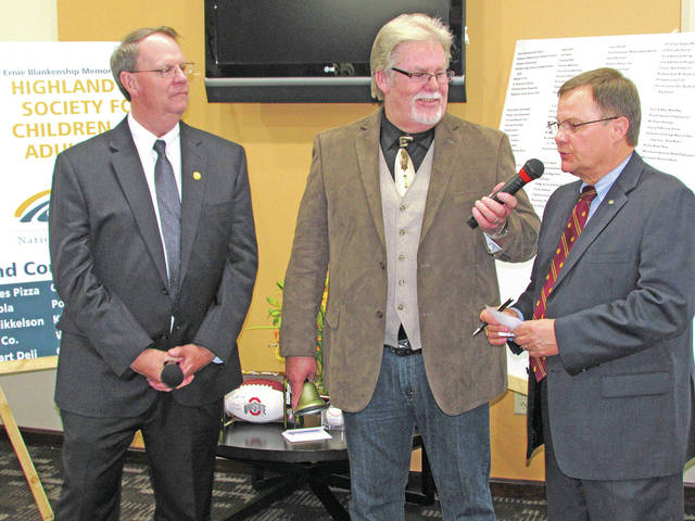 Co-hosts Rick Williams, left, and Herb Day, center, are pictured with Hillsboro Rotary Club member Rocky Coss during a past Ernie Blankenship Radio-Telethon for the benefit of the Highland County Society for Children and Adults.