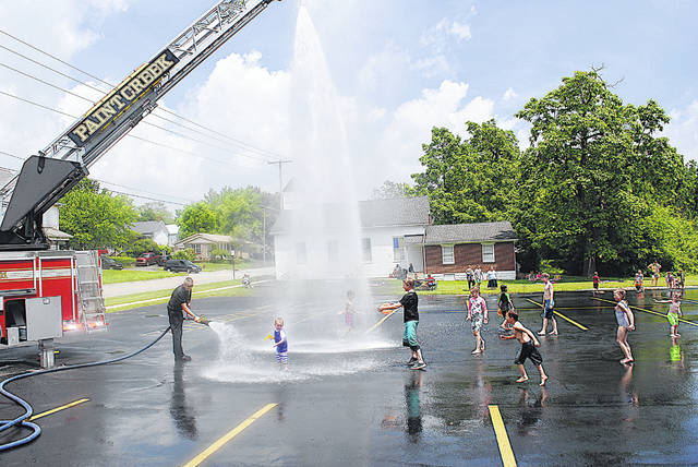 "More than 100 kids turned out Friday for the first of three Paint Creek Joint EMS/Fire District Water Days at the Hillsboro station. Two more days are planned from 11 a.m. t0 1 p.m. — Friday, June 12 at the Greenfield station and Friday, July 10 at the Hillsboro station. The fire district gave away plastic fire helmets, bracelets and Frisbees; the Hillsboro City Schools Tomahawk Food truck served free meals after the event; and Rent-2-Own gave away squirt guns. A Kona Ice truck was also on hand. ""We do this to try to show our community we're here with them together and to try to build a stronger connection with them, especially during these times we're going through,"" a Paint Creek spokesperson said. ""We want them to know we're here for them and to let the kids have some fun. We look forward to this all year long."""
