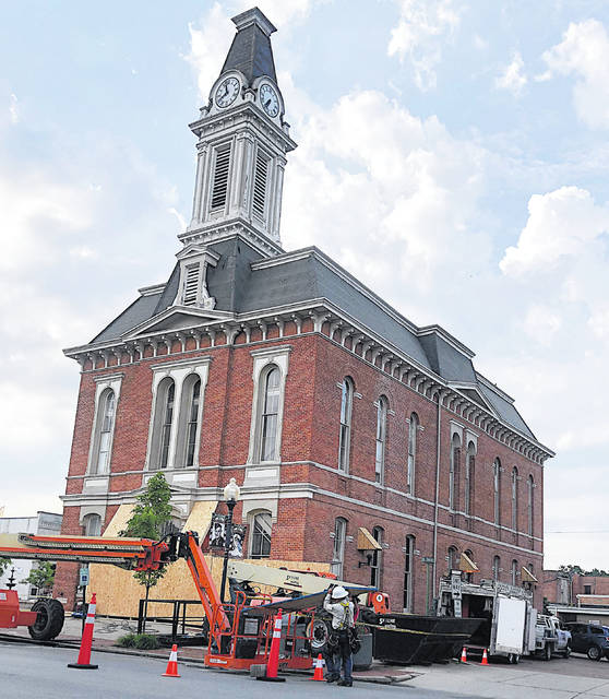 The Greenfield City Building is pictured as it undergoes roofing work. Restoration of the iconic clock tower is forthcoming.